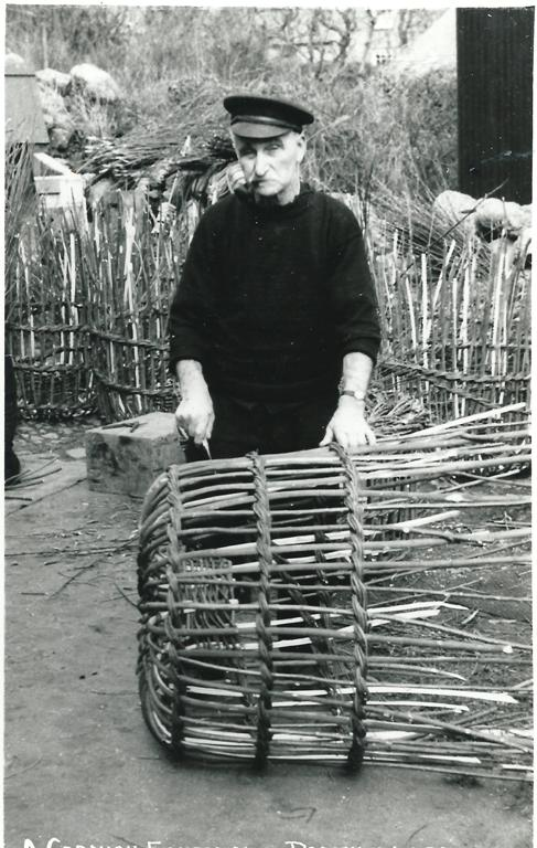 fisherman making withy pots at Porthgwarra, Postcard